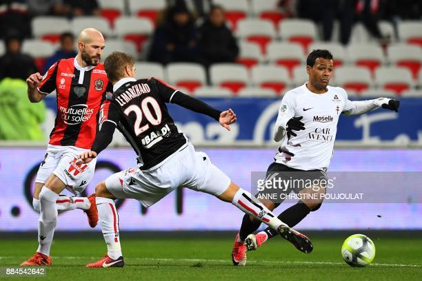 Nice's French defender Maxime Le Marchand vies with Metz's Togolese midfielder Matthieu Dossevi during the French L1 football match Nice vs Metz on...