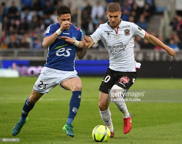 Nice's French defender Maxime Le Marchand vies with Strasbourg's French midfielder Jonas Martin during the French L1 football match between...