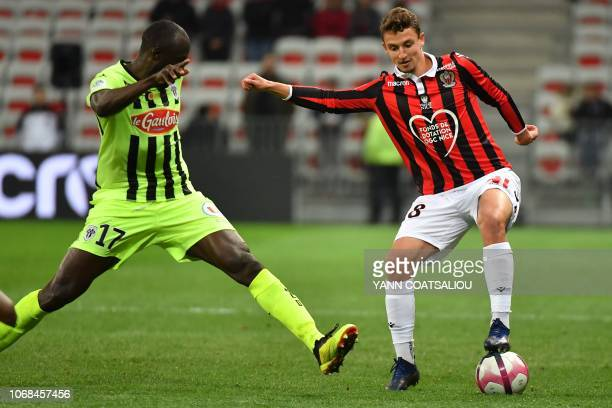 Nice's French defender Olivier Boscagli vies for the ball with Angers' Senegalese midfielder Cheikh Ndoye during the French L1 football match OGC...