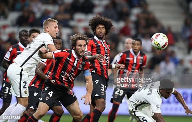 Nice's French defender Paul Baysse vies with Monaco's Polish defender Kamil Glik during the French L1 football match Nice vs Monaco on September 21...