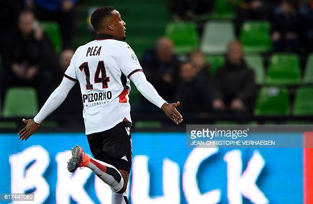 Nice's French forward Alassane Plea celebrates after scoring a goal during the French L1 football match between Metz and Nice on October 23 2016 at...