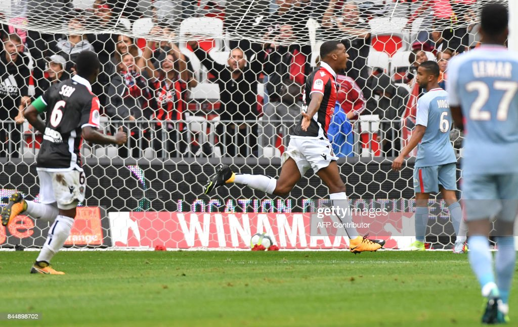 Nice's French forward Alassane Plea (C) celebrates after scoring a goal during the French L1 football match Nice (OGCN) vs Monaco (ASM) on September 9, 2017 at the 'Allianz Riviera' stadium in Nice, southeastern France. COATSALIOU