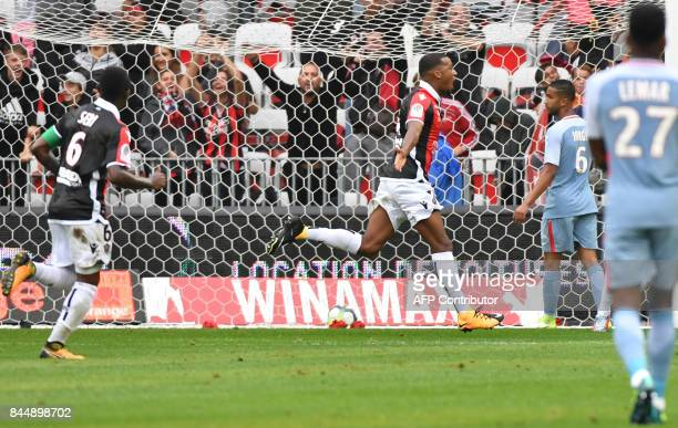 Nice's French forward Alassane Plea celebrates after scoring a goal during the French L1 football match Nice vs Monaco on September 9 2017 at the...