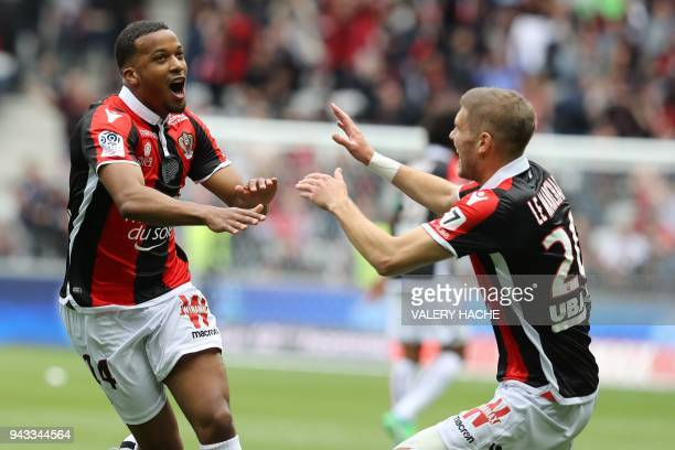Nice's French forward Alassane Plea celebrates after scoring a goal during the French L1 football match Nice vs Rennes on april 8, 2018 at the...