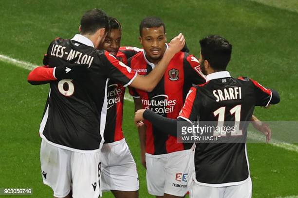 Nice's French forward Alassane Plea celebrates with teammates after scoring a goal during the French League Cup football match between Nice and...