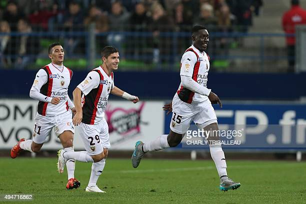 Nice's French forward Alexandre Mendy celebrates with teammates Jeremy Pied and Said Benrahma after scoring his second goal during the French League...