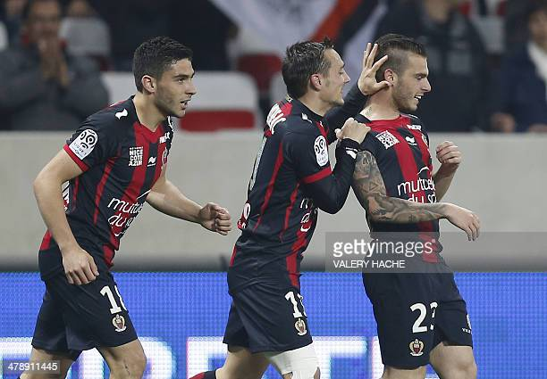 Nice's French forward Alexy Bosetti celebrates scoring a goal with teammates French forward Neal Maupay and French forward Eric Bautheac during the...
