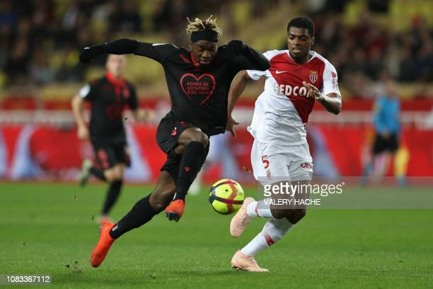 Nice's French forward Allan Saint-Maximin shoots to score past Monaco's Brazilian defender Jemerson during the French L1 football match between AS...