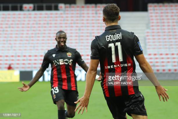 Nice's French forward Amine Gouiri celebrates with teammate Nice's French defender Hassane Kamara after scoring a goal during the French L1 football...