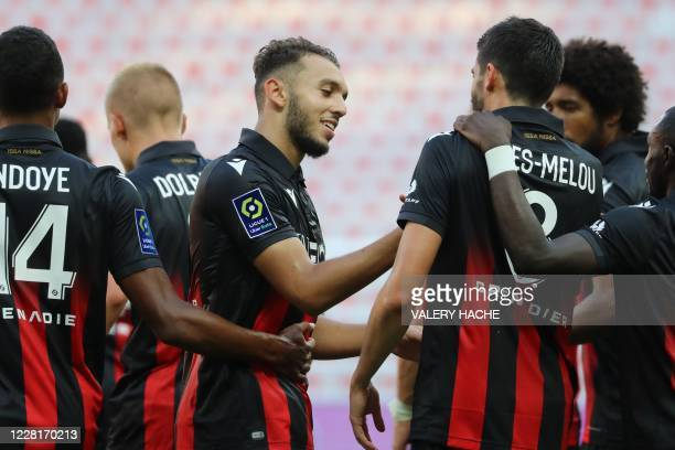 Nice's French forward Amine Gouiri celebrates with teammates after scoring a goal during the French L1 football match between Nice and RC Lens at The...