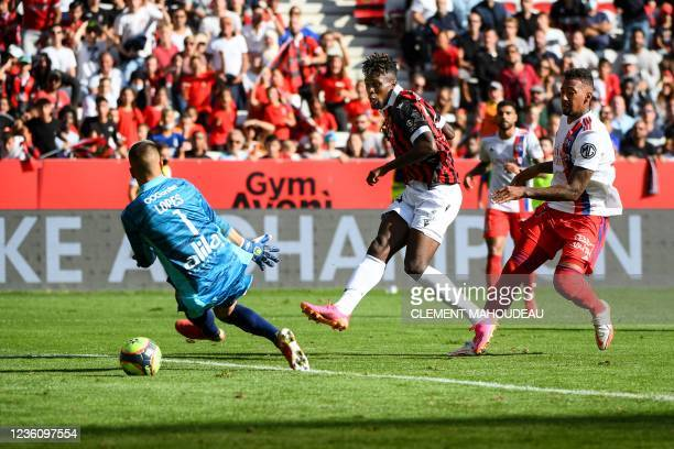 Nice's french forward Evann Guessand kicks to score Nice's third goal during the French L1 football match between OGC Nice and Olympique Lyonnais at...