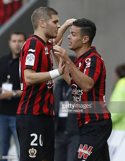 Nice's French forward Hatem Ben Arfa celebrates with a teammate after scoring a goal during the French L1 football match between Nice and Rennes on...