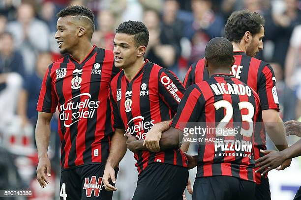 Nice's French forward Hatem Ben Arfa celebrates with teammates after scoring a goal during the French L1 football match between Nice and Rennes on...