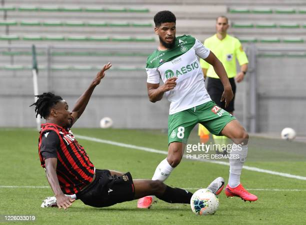 Nice's French forward Khephren Thuram fights for the ball with SaintEtienne's French midfielder Mahdi Camara during the French L1 friendly football...