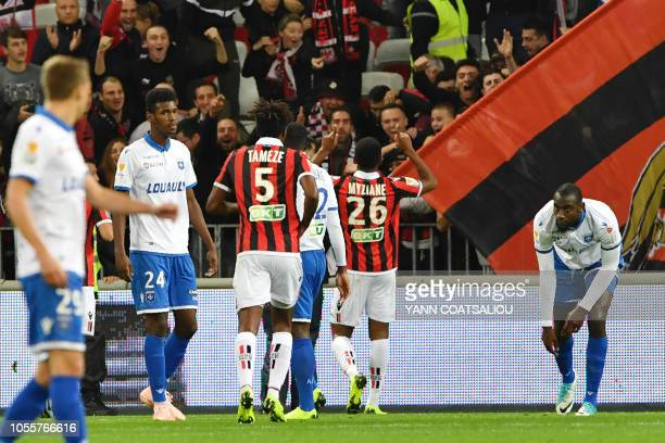 Nice's French forward Myziane Maolida celebrates with team mates and supporters after scoring a goal during the French League cup football match...