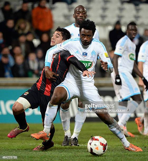 Nice's French forward Neal Maupay vies with Marseille's Cameroonian defender Nicolas Nkoulou on January 21 2014 at the Velodrome stadium in Marseille...