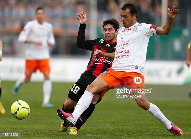 Nice's French forward Neal Maupay vies with Montpellier's Brazilian defender Vitorino Hilton during the French L1 football match Nice versus...