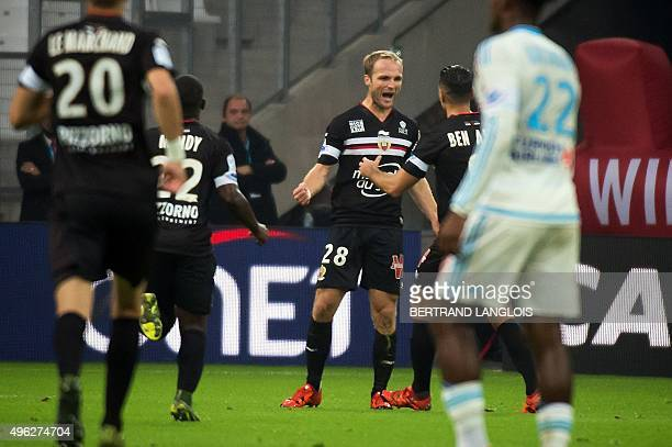 Nice's French forward Valere Germain celebrates with teammate Nice's French forward Hatem Ben Arfa after scoring during the French L1 football match...
