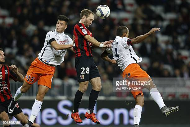 Nice's French forward Valere Germain jumps for the ball with Montpellier Algerian defender Ramy Bensebaini and Montpellier's Brazilian defender...