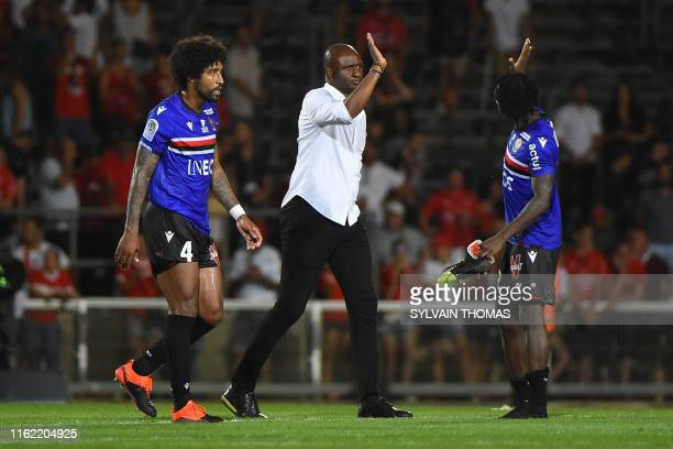 Nice's French head coach Patrick Vieira celebrates with Nice's French Midfielder Arnaud Lusamba after winning the French L1 Football match between...