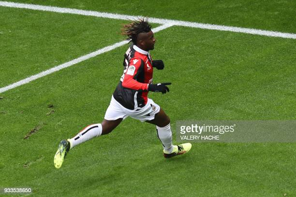 Nice's French midfielder Allan SaintMaximin celebrates after opening the scoring during the French L1 football match Nice vs Paris SaintGermain on...