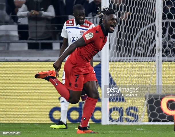 Nice's French midfielder Allan SaintMaximin celebrates after scoring a goal during the French L1 football match between Olympique Lyonnais and OGC...