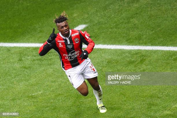 Nice's French midfielder Allan SaintMaximin celebrates opening the scoring during the French L1 football match Nice vs Paris SaintGermain on March 18...