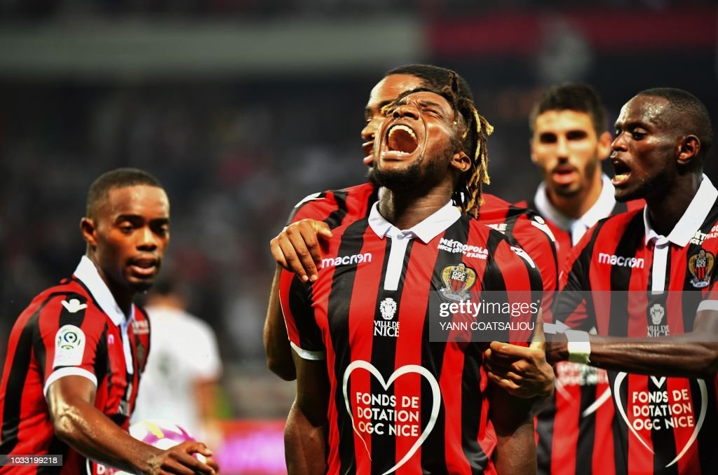Nice's French midfielder Allan Saint-Maximin (C) celebrates with teammates after scoring during the French L1 football match between Nice and Rennes at The 'Allianz Riviera' Stadium in Nice, southern France on September 14, 2018.