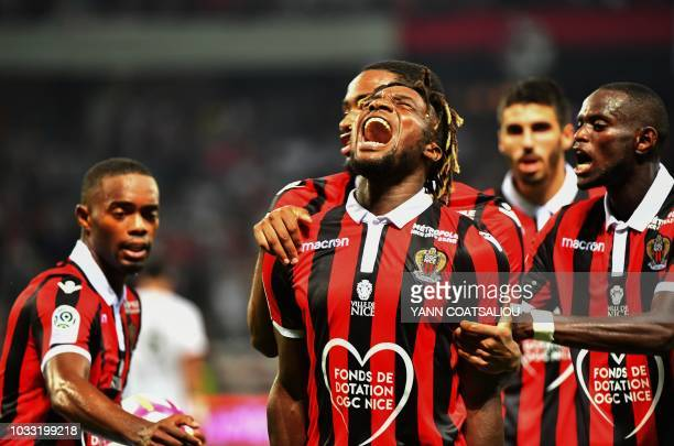 Nice's French midfielder Allan SaintMaximin celebrates with teammates after scoring during the French L1 football match between Nice and Rennes at...
