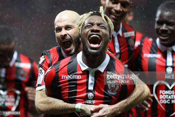 TOPSHOT Nice's French midfielder Allan SaintMaximin celebrates with teammates after scoring a goal during the French L1 football match between Nice...