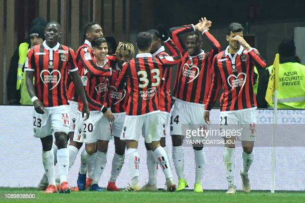 Nice's French midfielder Allan SaintMaximin celebrates with teammates after scoring a goal during the French L1 football match between Nice and Nimes...
