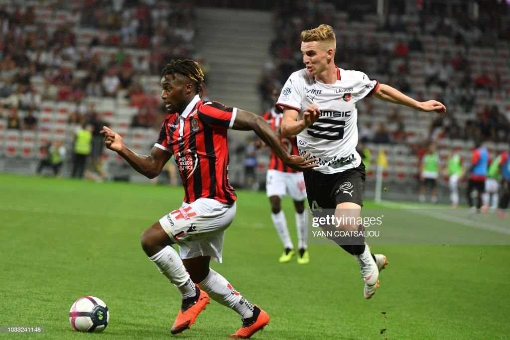Nice's French midfielder Allan Saint-Maximin (L) drives the ball forward during the French L1 football match between Nice and Rennes at The 'Allianz Riviera' Stadium in Nice, southern France on September 14, 2018.