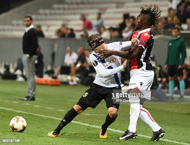 Nice's French midfielder Allan SaintMaximin fights for the ball with Vitesse Arnhem's Dutch defender Bryan Linssen during the UEFA Europa League...