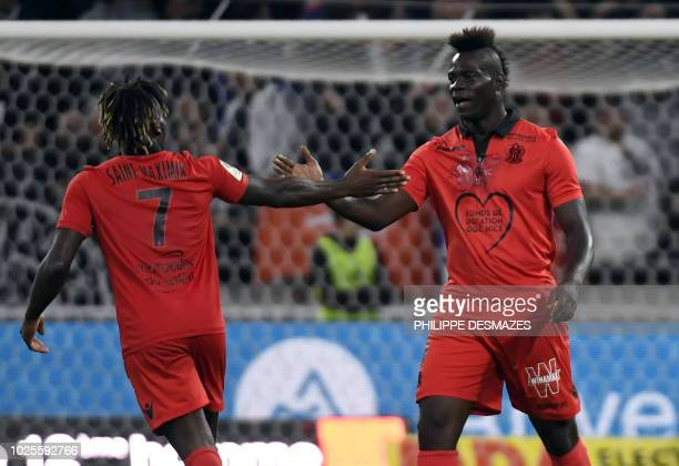 Nice's French midfielder Allan SaintMaximin is congratulated by Nice's Italian forward Mario Balotelli during the French L1 football match between...