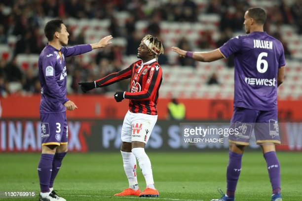 """Nice's French midfielder Allan Saint-Maximin reacts during the French L1 football match between Nice and Toulouse on March 15, 2019 at the """"Allianz..."""