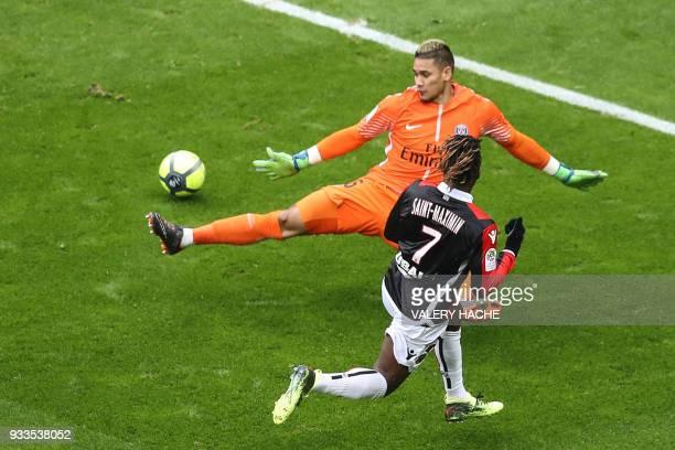 Nice's French midfielder Allan SaintMaximin slips the ball past Paris SaintGermain's French goalkeeper Alphonse Areola to open the scoring during the...
