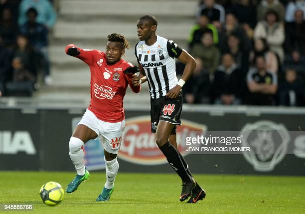 Nice's French midfielder Allan SaintMaximin vies with Anger's Congolese midfielder Prince Oniangue during the French L1 Football match between Angers...