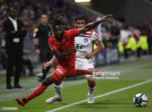 Nice's French midfielder Allan SaintMaximin vies with Lyon's French midfielder Nabil Fekir during the French L1 football match between during the...