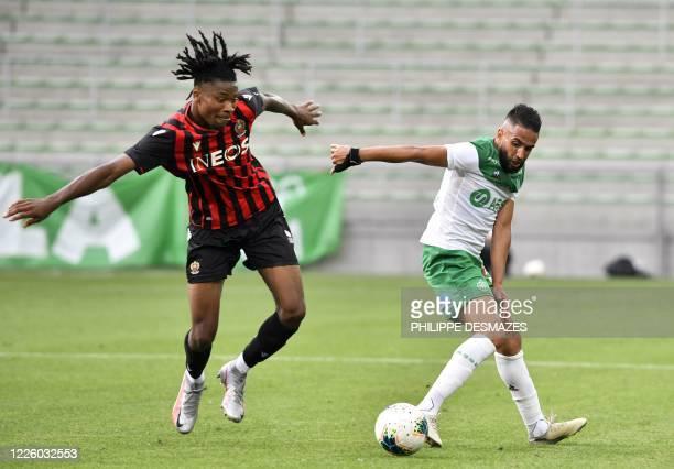 Nice's French midfielder Khephren Thuram fights for the ball with SaintEtienne's Algerian midfielder Ryad Boudebouz during the French L1 friendly...