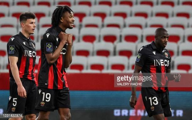 Nice's French midfielder Khephren Thuram , Nice's Austrian defender Flavius Daniliuc and Nice's French defender Hassane Kamara react after winning...