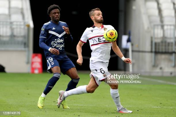 Nice's French midfielder Morgan Schneiderlin vie Josh Maja Battle during the French L1 football match between Bordeaux and Nice on September 27, 2020...