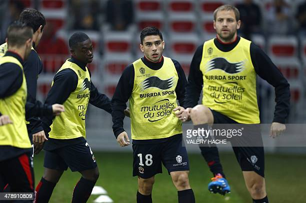Nice's French midfielder Nampalys Mendy Nice's French forward Neal Maupay and Nice's French midfielder Mathieu Bodmer warm up prior to French L1...