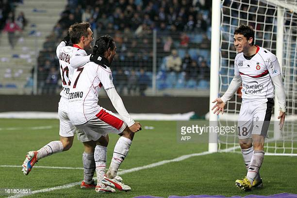 Nice's French midfielder Neal Maupay celebrates with teammates after scoring a goal during the French L1 football match Bastia vs Nicein the Armand...