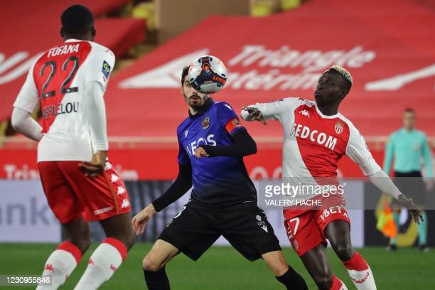 Nice's French midfielder Pierre Lees-Melou and Monaco's Senegalese forward Krepin Diatta eye the ball during the French L1 football match between AS...