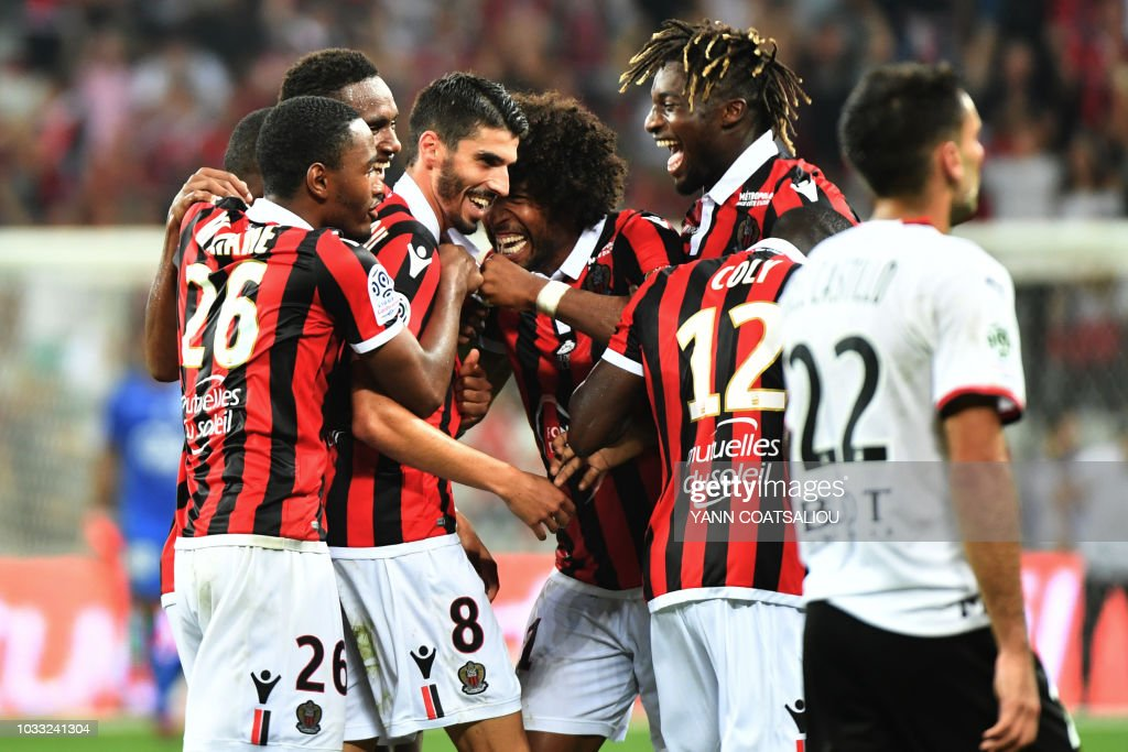 Nice's French midfielder Pierre Lees-Melou (C/#8) celebrates with teammates after scoring his team's second goal during the French L1 football match between Nice and Rennes at The 'Allianz Riviera' Stadium in Nice, southern France on September 14, 2018.