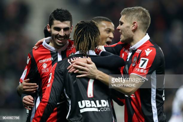 Nice's french midfielder Pierre LeesMelou celebrates with teammates after scoring a goal during the French L1 football match Nice vs Amiens on...