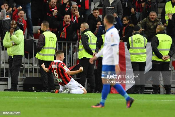 Nice's French midfielder Remi Walter celebrates after he scored a goal during the French League cup football match between Nice and Auxerre on...