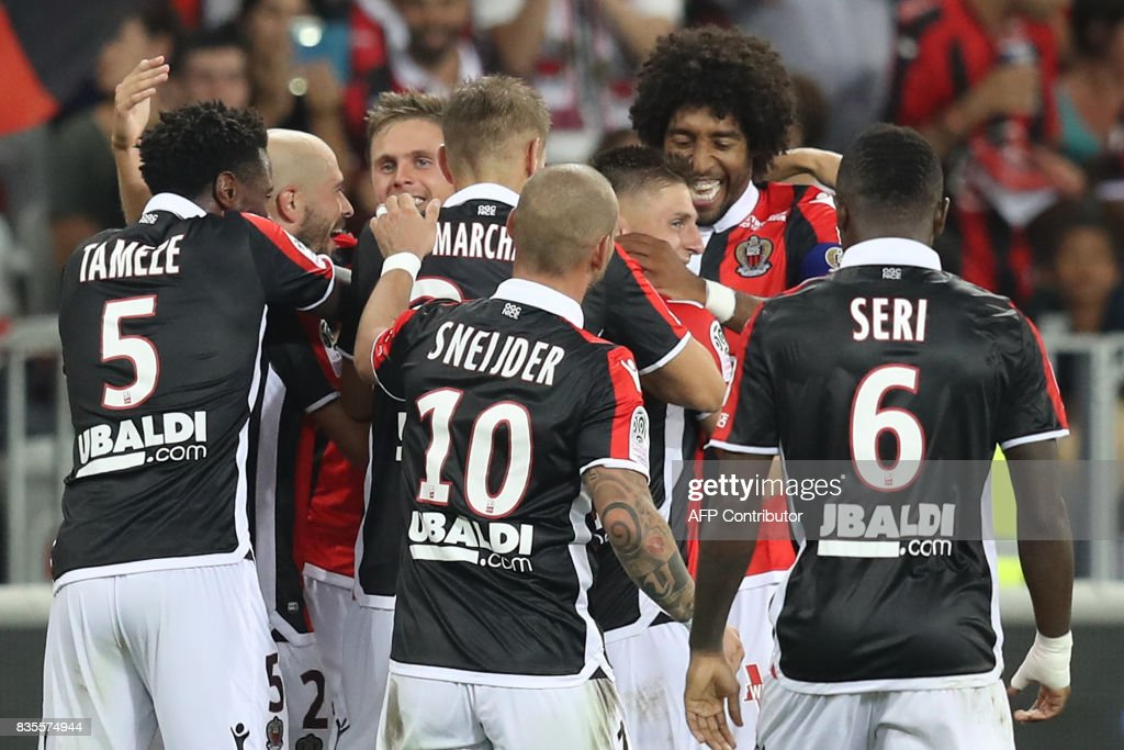 Nice's French midfielder Remi Walter (3rd-R) celebrates with his teammates after scoring a goal during the French L1 football match Nice (OGCN) vs Guingamp (EAG) on August 19, 2017 at the 'Allianz Riviera' stadium in Nice, southeastern France. /