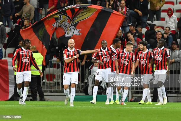 Nice's French midfielder Remi Walter celebrates with team mates after he scored a goal during the French League cup football match between Nice and...