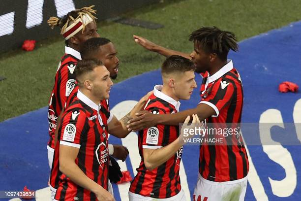Nice's French midfielder Remi Walter is congratulated by teammates during the French L1 football match between OGC Nice and Olympique Lyonnais at the...